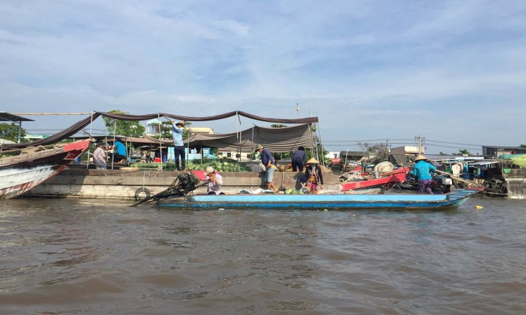 Transaction in the Cai Rang Floating Market in Can Tho, Vietnam