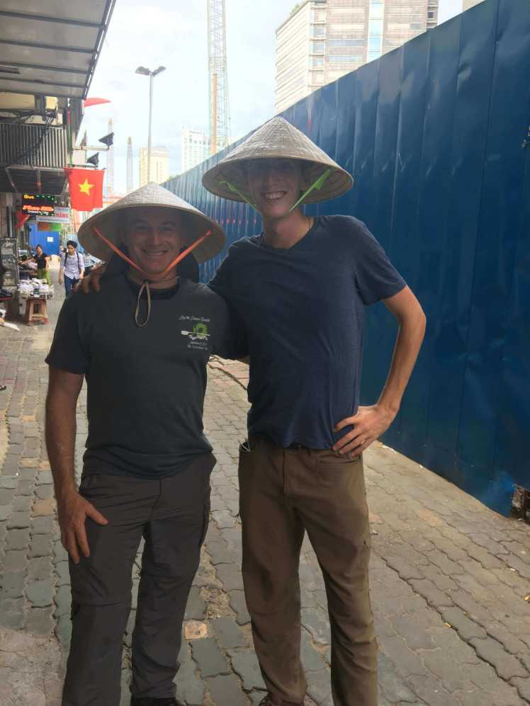 Wearing Vietnamese Cone Hats in Ho Chi Minh City (Saigon), Vietnam