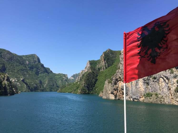 Albanian Flag over Lake Koman, Albania