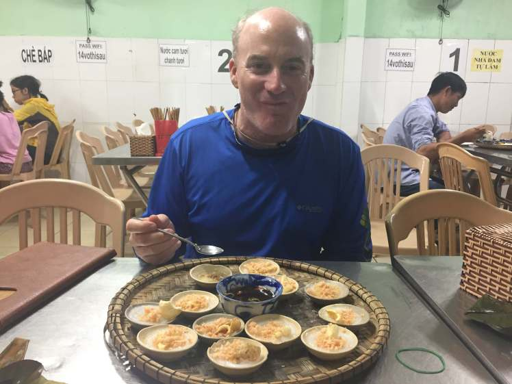 Don't mind the chewing expression – we both loved the bánh bèo!
