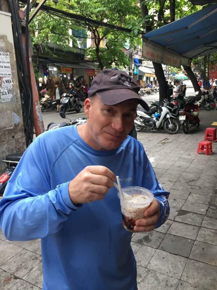 Dad Trying Che in Hanoi, Vietnam