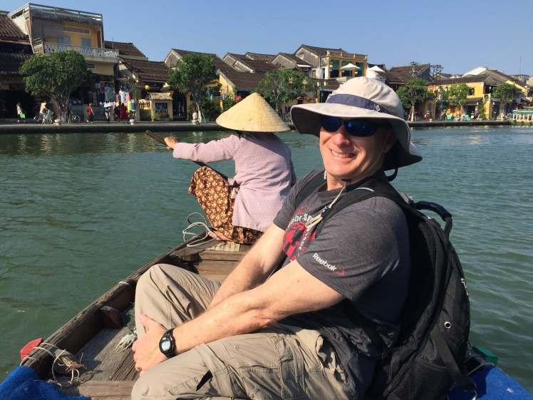 Taking a sampan ferry across the the river in Hội An.