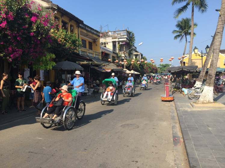 Tourist chariots parading through the picturesque streets of Hội An.